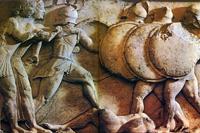Фрагмент фриза сокровищницы сифнийцев с Аполлоном и Артемидой (слева). Около 525 г. до н.э. Дельфы